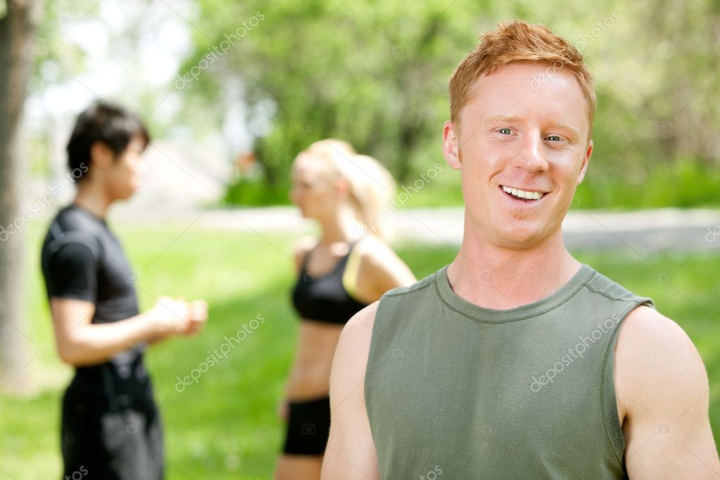 Portrait of a man with friends in the background