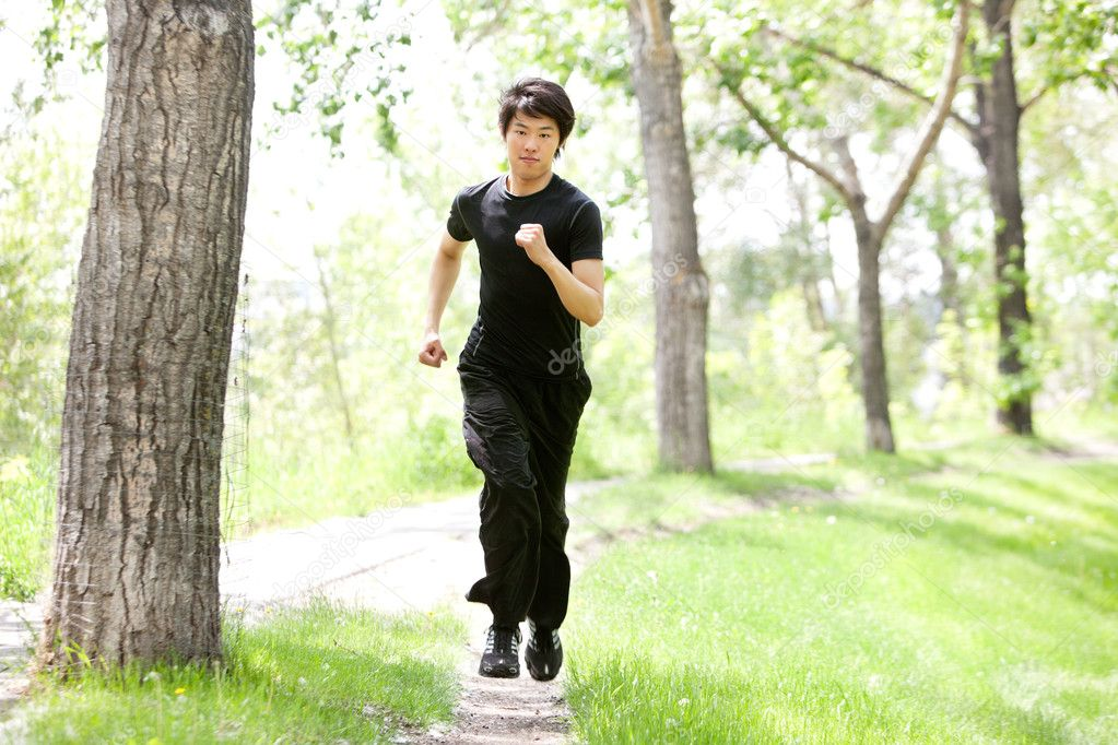 Portrait of man running in a park