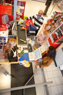 Shop assistant with customer