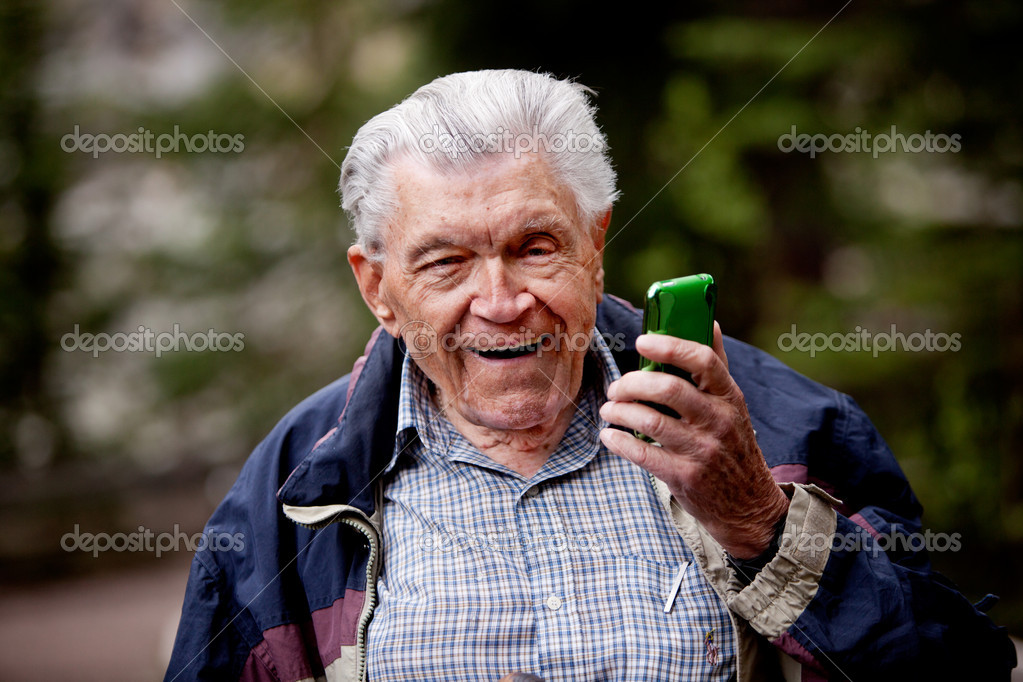 Old Man With Cell Phone Stock Photo By C Simplefoto 5710541