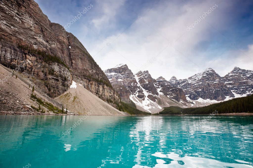 Calm water and mountain range