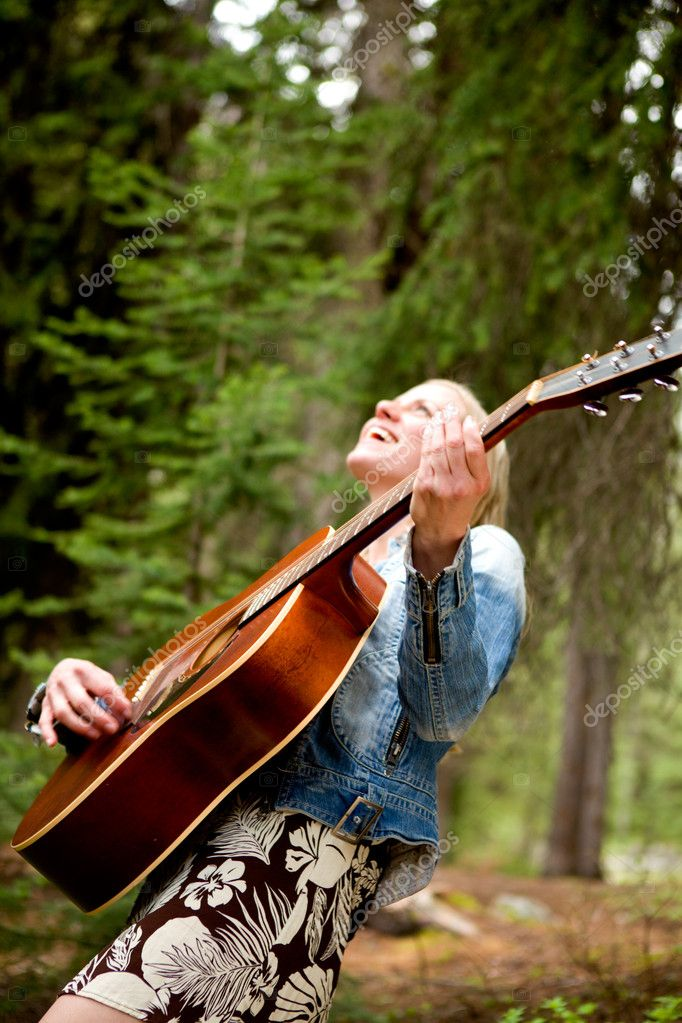 Woman Singing Free in the Forest