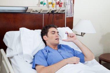 Patient using asthma inhaler