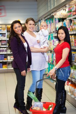 Mother with Child and Friends in Supermarket