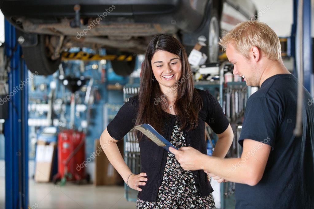 Happy Female Customer at Mechanic