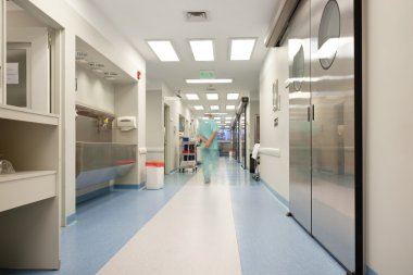 Doctor walking through hospital corridor