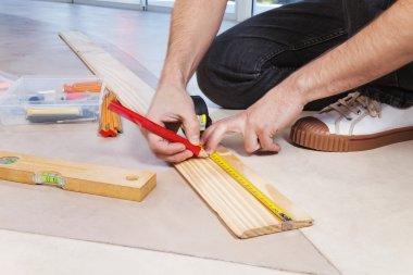 Man marking on plywood
