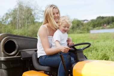 Mother and Child mowing grass