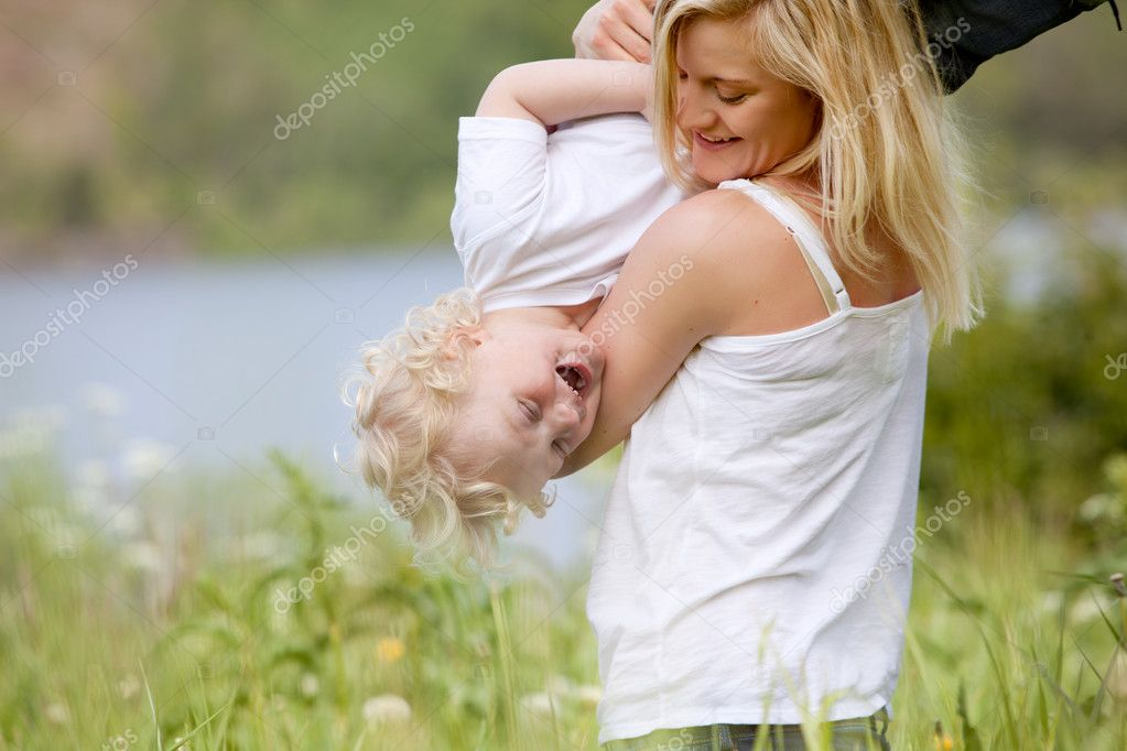 Mother and Son Playing in Meadow
