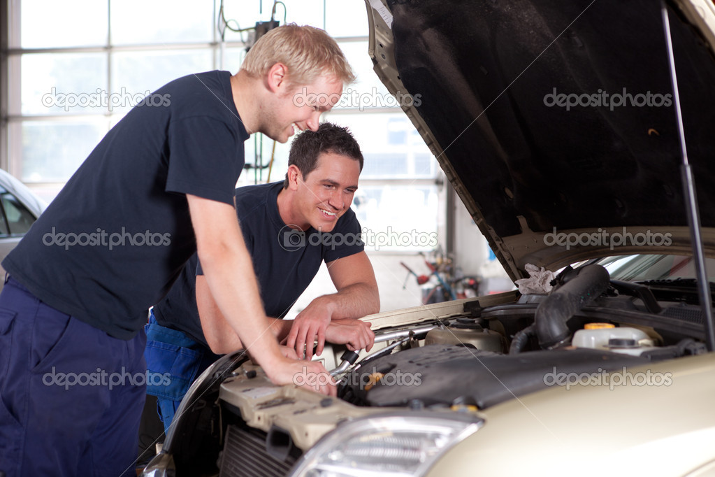 Mechanics in Auto Repair Shop