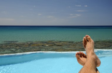 Picture of male legs over swimming pool