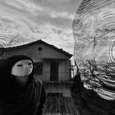 Masked figure behind threaded window