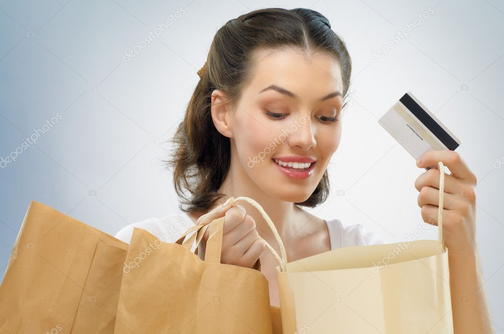 Beautiful woman with shopping bags in hands