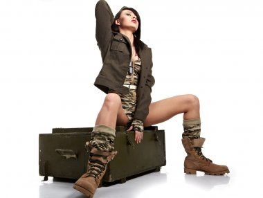 Beautiful woman in military clothes. stock vector