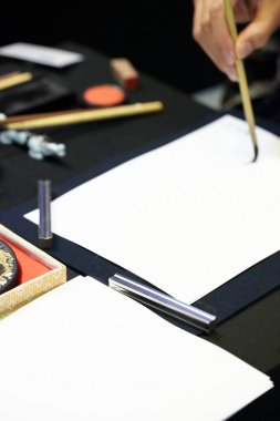 Chinese painting and calligraphy on white paper