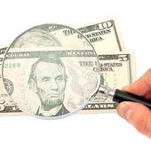 lupou v ruce a peníze