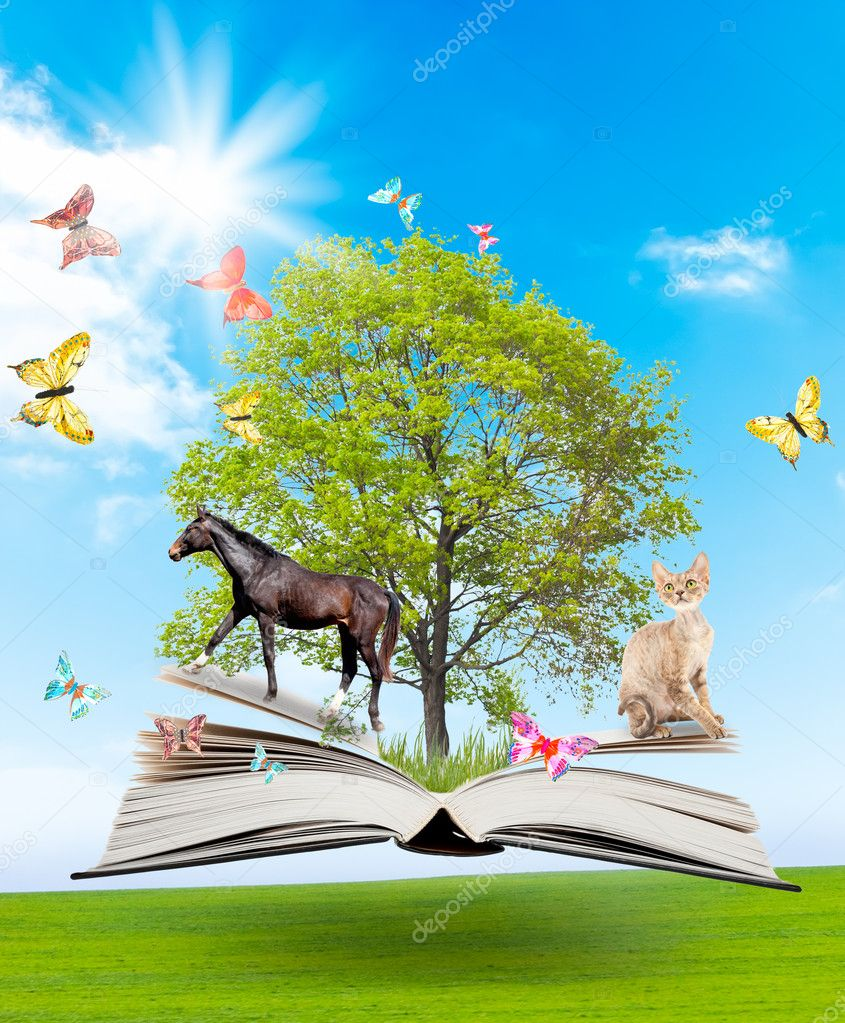 Magic book with a green tree and diferent animals