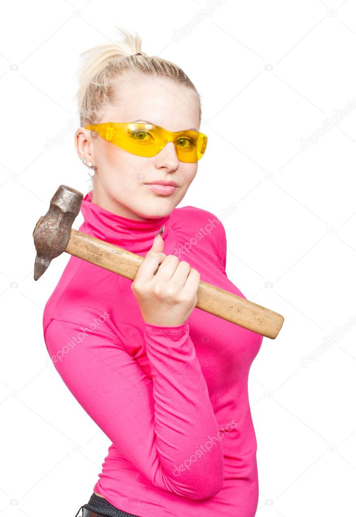 Beautiful blonde in the yellow glasses and a hammer in his hand