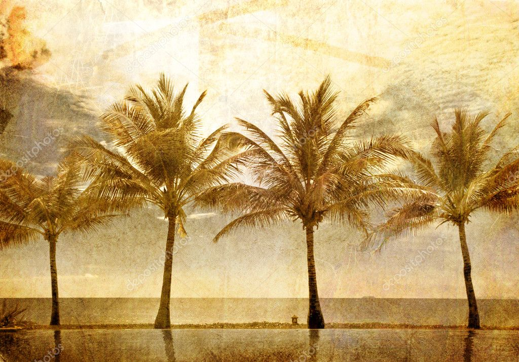 Reflections of palms in the pool
