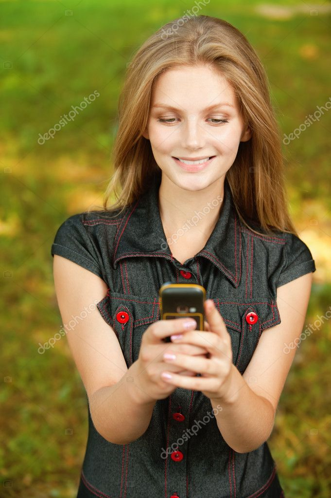 Girl with cellular telephone