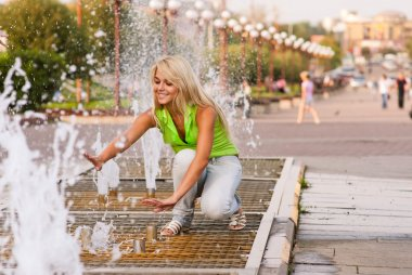 Girl about fountain
