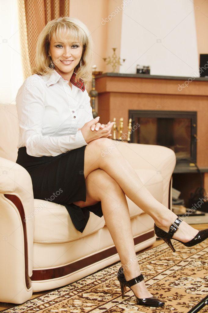 Business woman sits on sofa