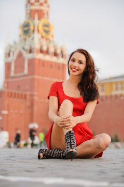 Woman against Spassky tower in Moscow