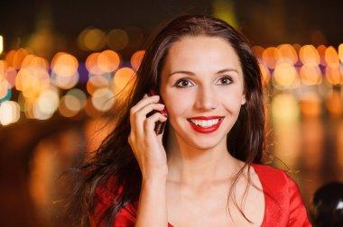 Woman talks on cellular telephone