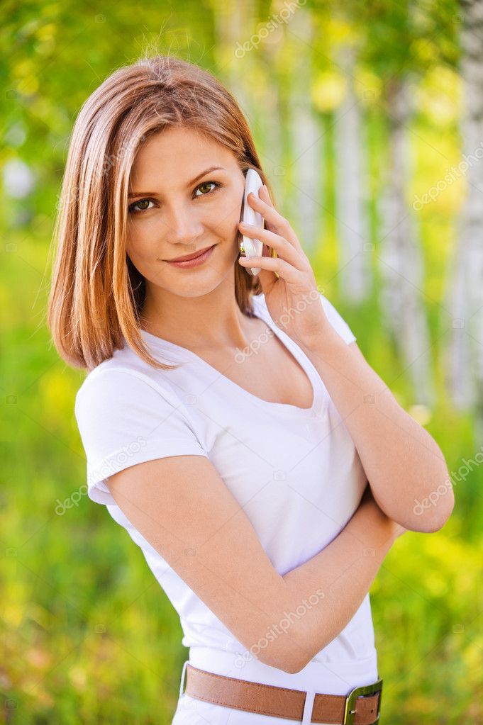 Portrait of woman speaking on phone