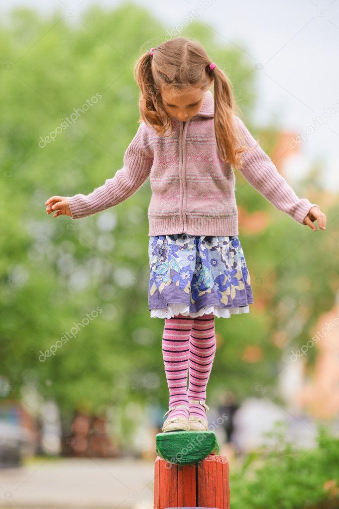 Little cute girl on playground