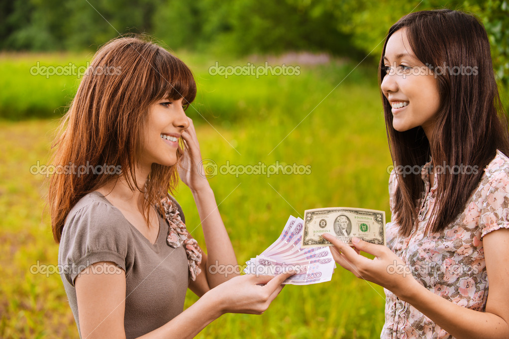 Two young women concluding bargain
