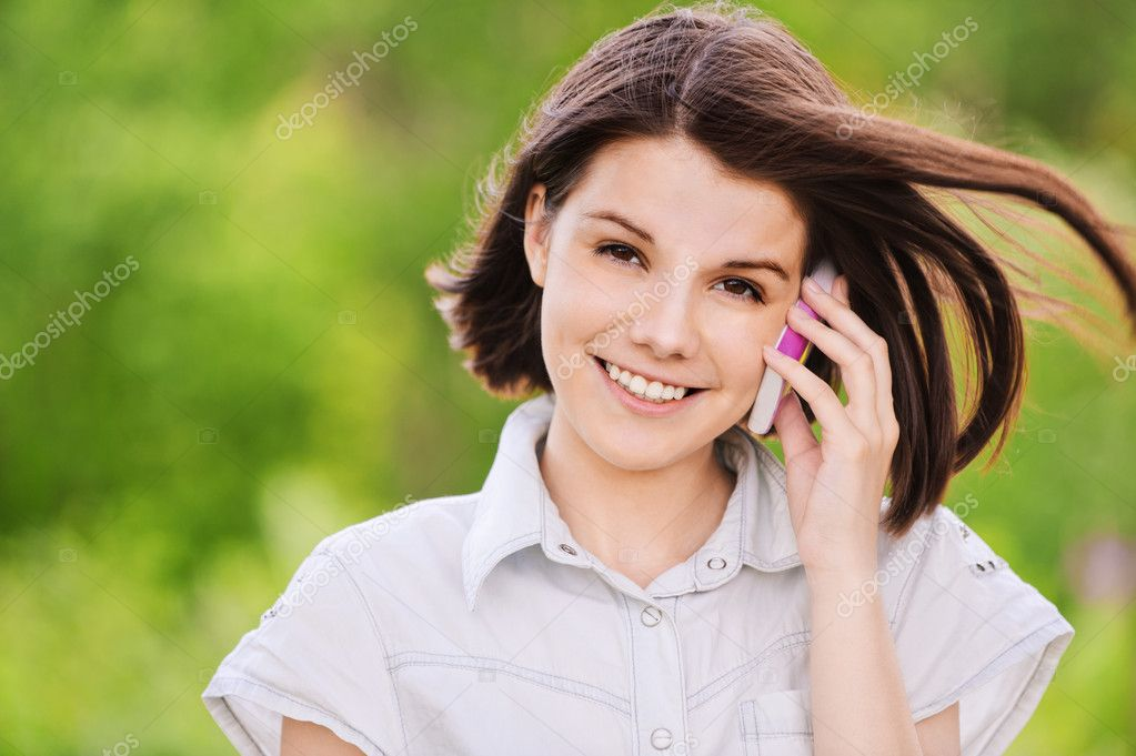 Portrait of young woman speaking on mobile