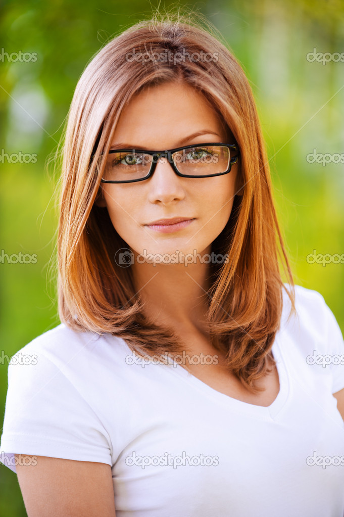 Ortrait Of Young Woman Wearing Glasses