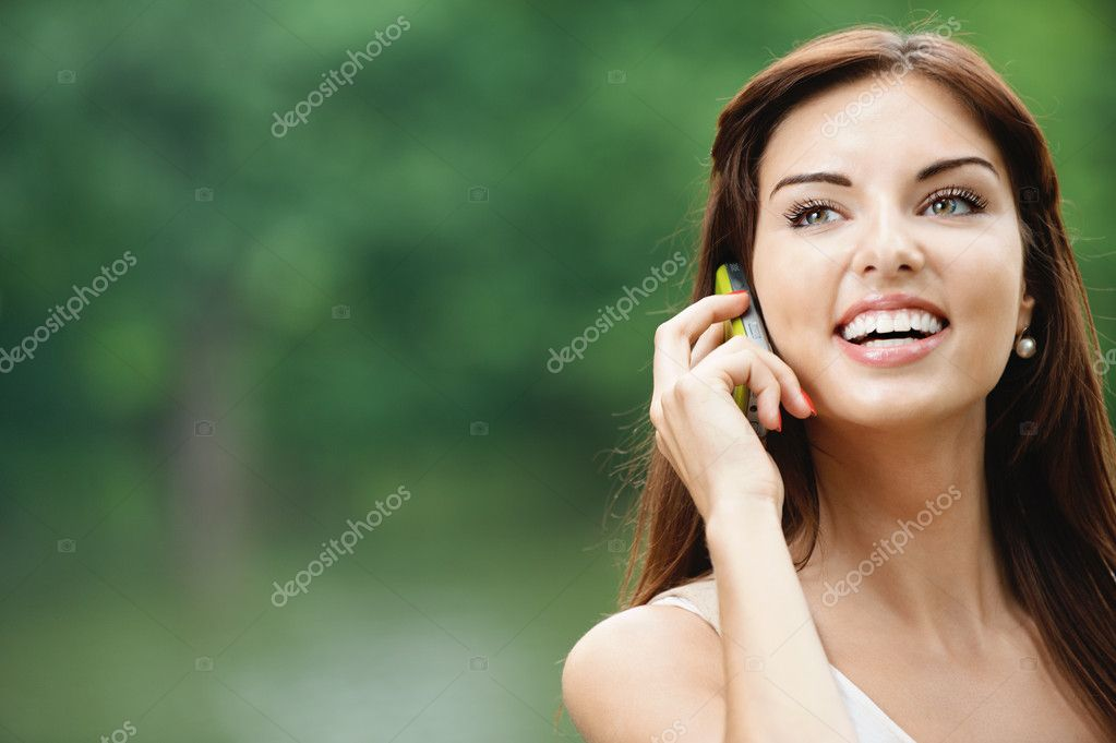 Portrait of young lady speaking on mobile phone