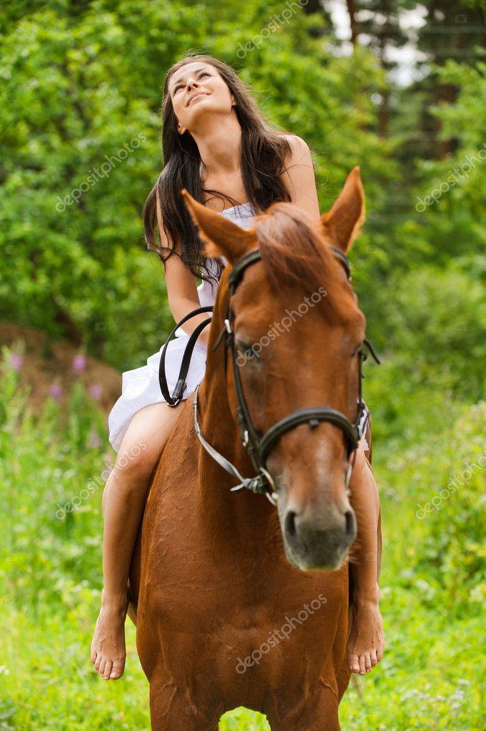 https://static6.depositphotos.com/1003410/630/i/950/depositphotos_6304304-stock-photo-young-smiling-woman-riding-horse.jpg