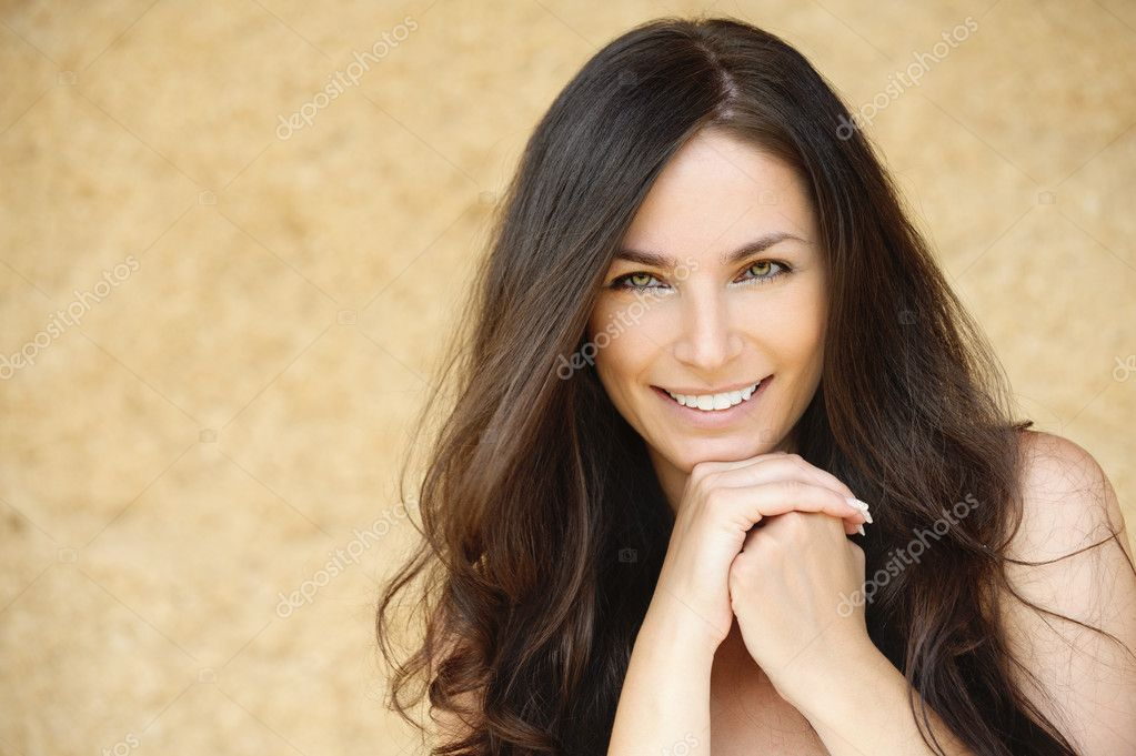 Portrait of beautiful smiling young woman