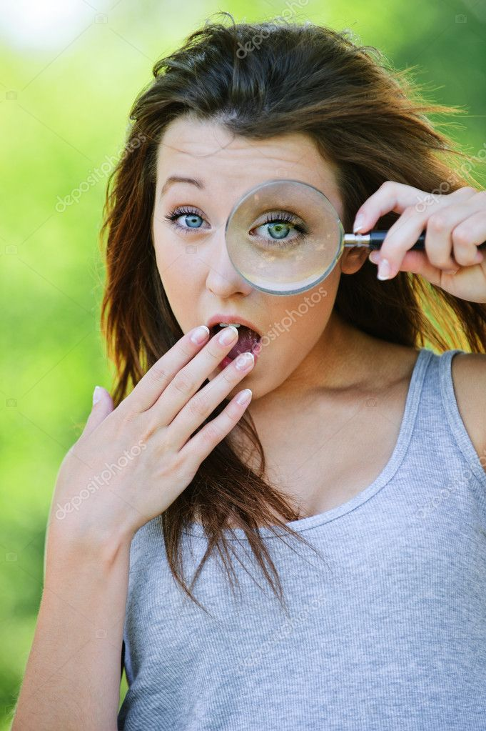 Funny girl with loupe