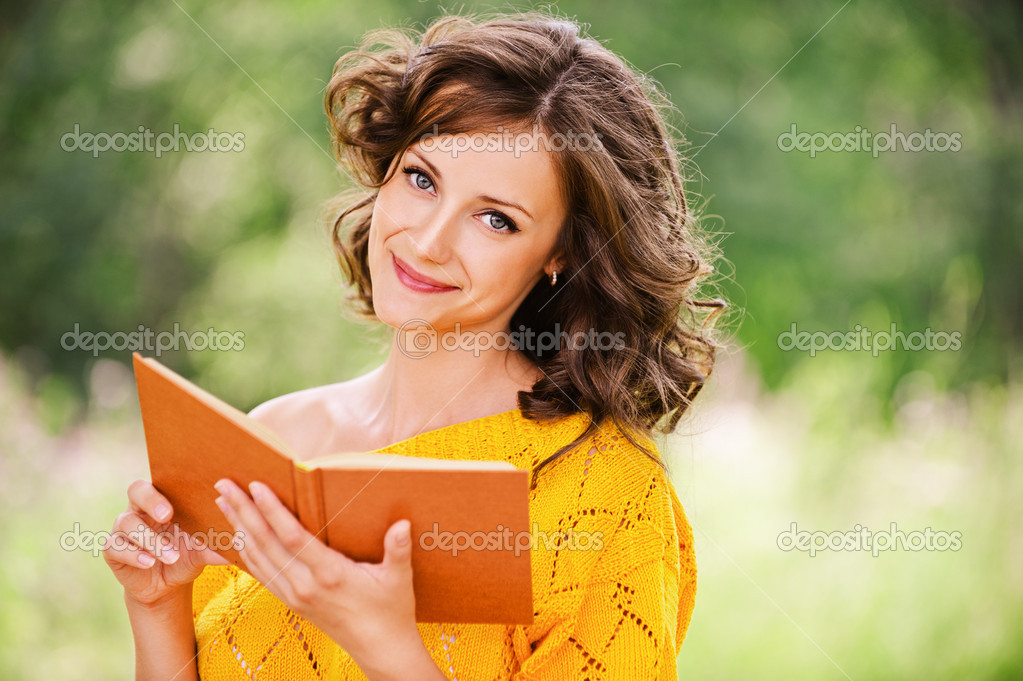 Portrait of beautiful woman holding book