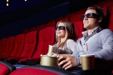 Young couple in 3D cinema