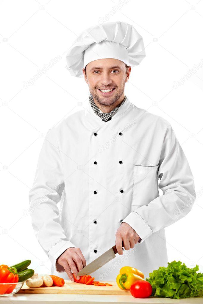 Le jeune cuisinier coupe les l gumes photographie for Cuisinier 3 etoiles legumes