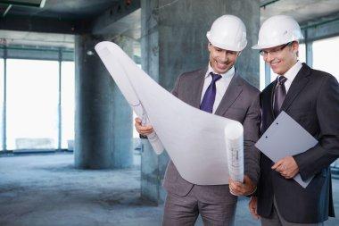 Businessmen held on site plan stock vector