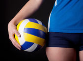 Photo Part of womans body with ball