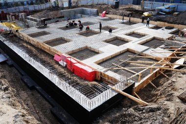 Construction of concrete foundation of building