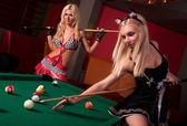 Fotografie Happy girls playing in billiard