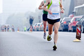 Fotografie running in city marathon