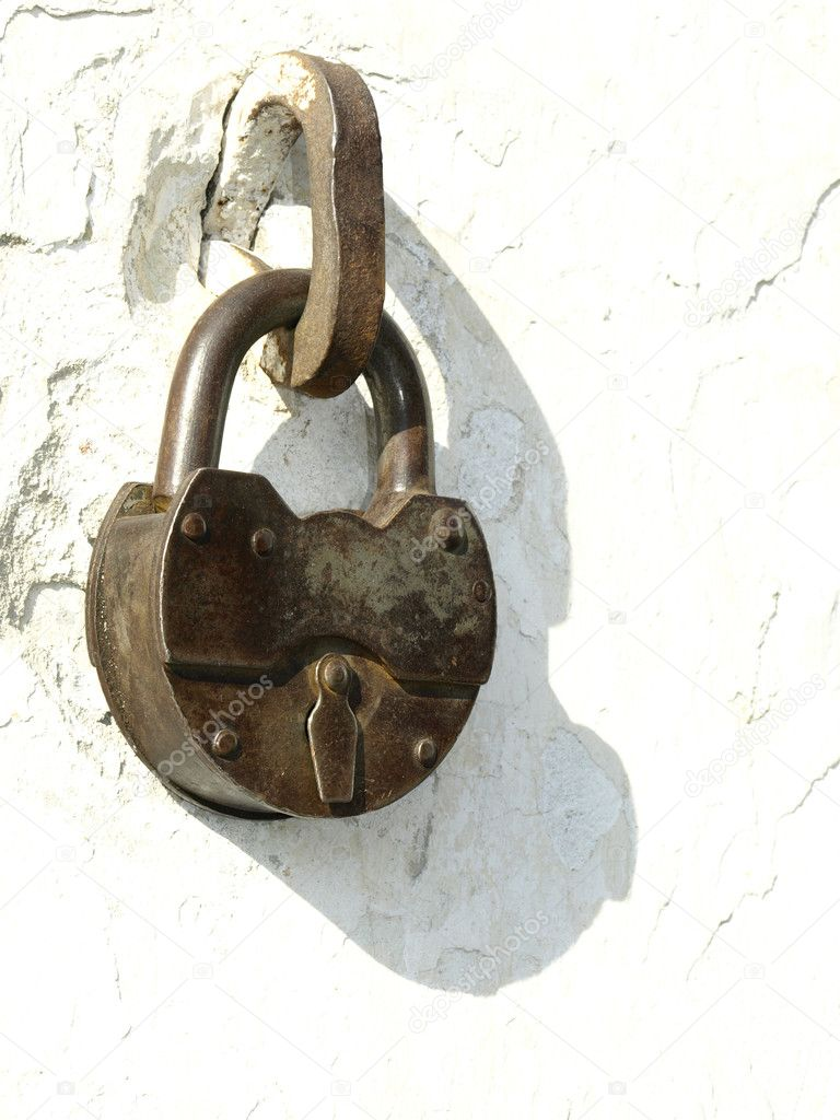 old locks on a white background of an old wall stock photo