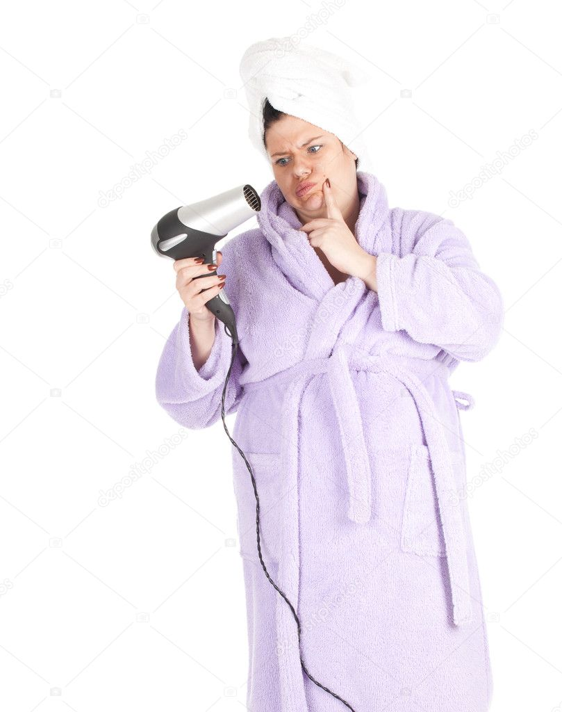 Fat woman in bathrobe and towel on head
