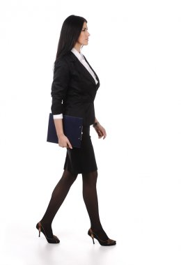 Business woman walks on heels with documents in hands, isolated