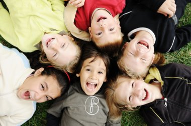Happiness without limit, happy group of children in circle, together outdoo