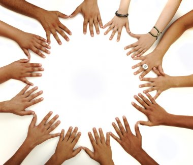 Conceptual symbol of multiracial children hands making a circle on white b